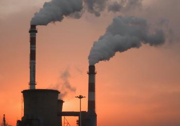 Energy plant with pollution pouring out of two chimneys in China